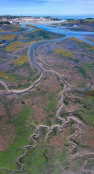 Aerial view at low tide of Escudo river and Rubin marsh in Oyambre Natural Park of San Vicente de la Barquera village by the Cantabrian Sea in Cantabria Autonomous Community of Spain, Europe