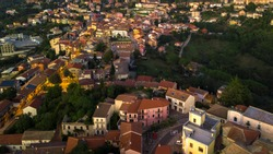 Aerial view at sunset of the small town of Montecalvo Irpino, in the province of Avellino, in Italy. This village with few houses and streets is built in the mountains of Irpinia