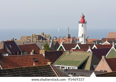Aerial view at the lighthouse and roofs of an old characteristic fishing village in the Netherlands