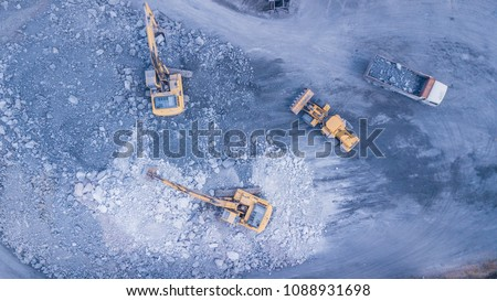 Aerial view, backhoe are working in quarries