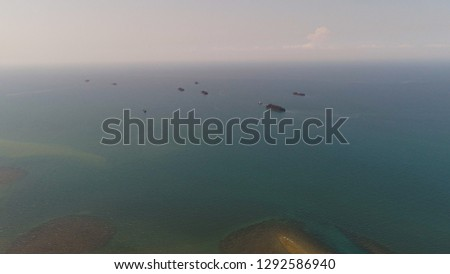 aerial view barges full coal anchored at sea near coal fired power station waiting be transported. coal barges and tugboats java, paiton indonesia