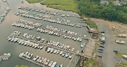 Aerial view boats in little port in ocean a little marina along the dockside