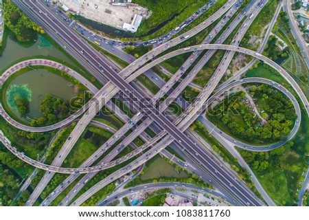 Aerial view car movement on traffic junction road with green tree park, Transport concept #1083811760