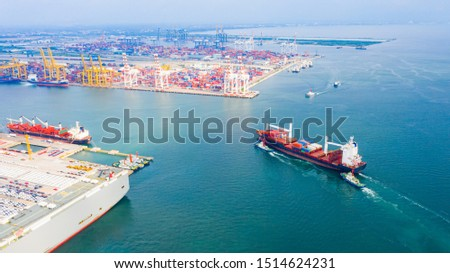Aerial view cargo ship of business logistic transportation sea freight,Cargo ship, Cargo container in factory harbor at industrial estate for import export around in the world, Trade Port / Shipping