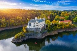 Aerial view chateau Orlik, above Orlik reservoir in beautiful autumn nature. Romantic royal Schwarzenberg castle above water level. Czechia. Orlik castle across the River Vltava, Czech Republic.