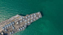 Aerial view close up USA warship navy nuclear aircraft carrier, America military navy ship airplane carrier full loading plane fighter jet aircraft in open ocean, United States of America.