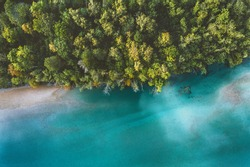 Aerial view coniferous forest and river drone landscape in Norway above trees and blue water scandinavian nature wilderness top down scenery