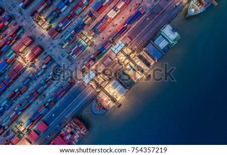 aerial view dock, container ship for Logistic, Trade for Container Cargo ship and Cargo plane with working crane bridge in shipyard at sunrise, logistic import export and transport industry background #754357219