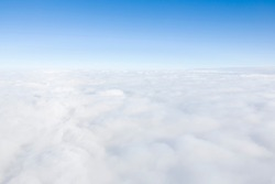Aerial view flying above clouds in the atmosphere, depicts heaven, Earth and the environment
