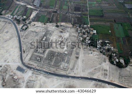 Aerial view form hot air balloon desert sand and green field Luxor Egypt