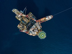 Aerial view from a drone of an offshore jack up rig at the offshore location during day time