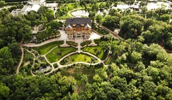 aerial view from a quadrocopter in the national park of Ukraine Mezhyhirya. luxury wooden castle house in Ukraine. residence of president.