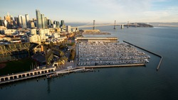 Aerial view from above McCovey Cove in the San Francisco Bay shows the South Beach Marina, the SOMA district, the San Francisco-Oakland Bay Bridge, and the rising skyline of Rincon Hill