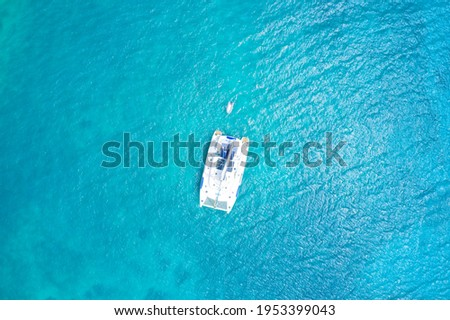 Aerial view from above of a luxury yacht in water Curieuse Island, Seychelles. Stock photo ©