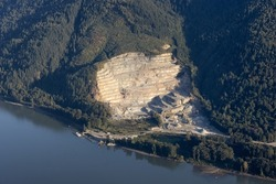Aerial View from Airplane of a Quarry open-pit mine where Sand and Gravel is excavated. Abbotsford, British Columbia, Canada.