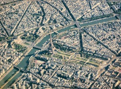 Aerial view from airplane of Paris with Eiffel Tower .