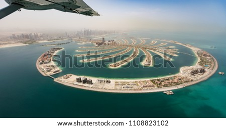 Aerial view from airplane window, artificial palm island in Dubai. Panoramic view. stock photo