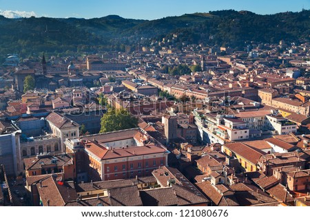 aerial view from Asinelli Tower on Bologna with mountain, Italy - stock photo