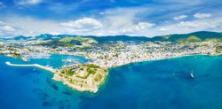 Aerial view from drone of popular resort town Bodrum in Turkey. Beautiful blue sky with white clouds, blue sea with clear water. Bodrum Castle overlooks harbour and marina.