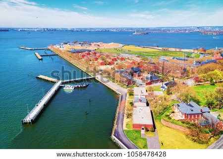 Aerial view from helicopter of Governors Island in Upper New York Bay. New York City, NYC, USA. Liberty Island is on the background