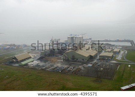 Aerial view from helicopter to factory in Iceland.