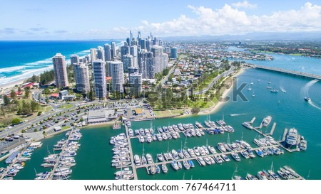Aerial view from Marina Mirage harbour and yachts, with a view over to Main Beach and Surfers Paradise cityscape #767464711