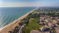 Aerial. View from the sky at the tourist town Dunas Douradas, Vale de Lobo.