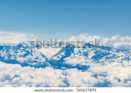 Aerial view from window plane of andes range mountains over chilean territory. #760637899