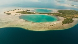 aerial view Honda bay with tropical islands and sandy beaches surrounded by coral reef with azure water, top view. Summer and travel vacation concept, Puerto princesa, Palawan, Philippines.
