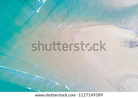 Aerial view Idyllic clear white sand sea beach turquoise water summer vacation background #1127149589