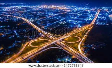 aerial view interchange ring road and motorway freeway highways and moving headlight cars transportation with over lighting the city background at night aerial view Thailand Stock photo ©