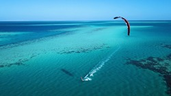 Aerial view. Kite surfing on the blue sea in the background of beautiful clouds