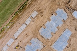 Aerial view landscape of construction on the preparation of the work for unfinished with foundation to new house construction in the suburbs