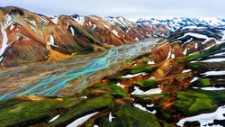 Aerial view landscape of Landmannalaugar surreal nature scenery in highland of Iceland, Europe. Beautiful colorful snow mountain terrain famous for summer trekking adventure and outdoor walking.