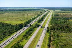 aerial view looking north, of Florida's Turnpike (left) and I-95 (right) in north Palm Beach County, Florida