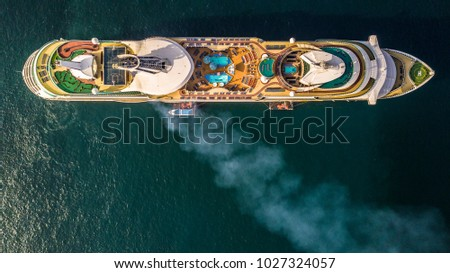 Aerial view luxury large cruise ship at sea, Big passenger cruise liner ship vessel boat with blue swimming pool, Sailing destination across the Gulf of Thailand.