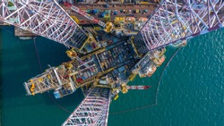 Aerial view maintenance repair of the jack up oil and gas rig up in the shipyard, Offshore oil and Gas processing platform, oil and gas industry.