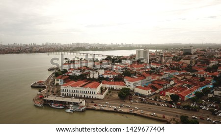 Aerial view Market of Tulhas and historical buildings decorated by the government with flags of sao joao in the center of the city of sao luis do maranhao, brazil Stockfoto ©