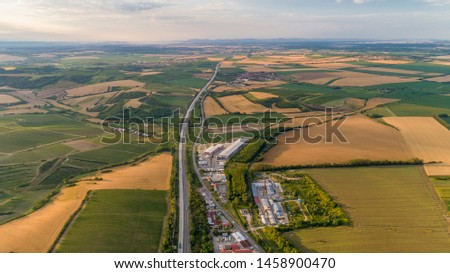 Aerial view Moravia region. D1 motorway is main highway system. Highways in Czech Republic. Motorways Expressways. Hustopeсe town. countryside near Palava and Novomlynske reservoirs. Straight road #1458900470