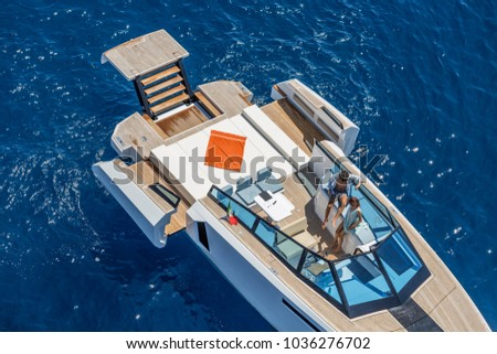 aerial view motor boat, new modern motor yacht on the sea with couple of people on luxury lifestyle