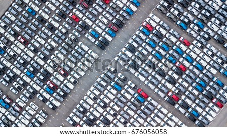 Aerial view new car lined up in the port for import and export business logistic to dealership for sale, Automobile and automotive car parking lot for commercial business  industry. Stockfoto ©