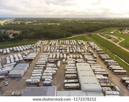 Aerial view new, pre-owned and consigned recreational vehicle at RV dealership, consignment parking lots in Houston, Texas, USA