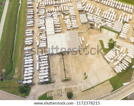 Aerial view new, pre-owned and consigned recreational vehicle at RV dealership, consignment parking lots in Houston, Texas, USA #1172378215