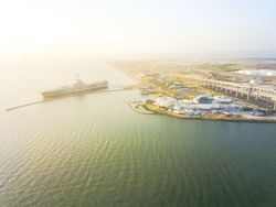 Aerial view North Beach in Corpus Christi, Texas, USA with aircraft carrier ship