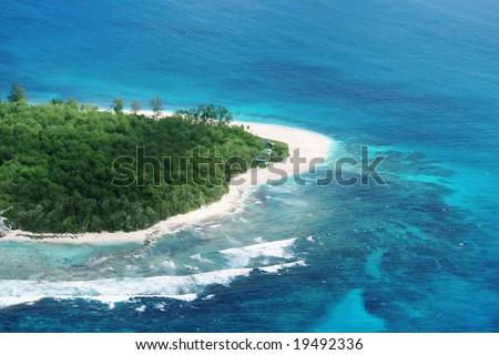 Aerial view of a beach on a tropical island