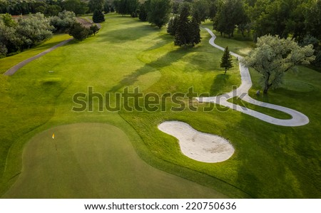 Aerial view of a beautiful green golf course.