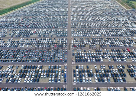 Aerial view of a Big car park of a shopping center, full of cars. Concept: Traffic, transport, work.