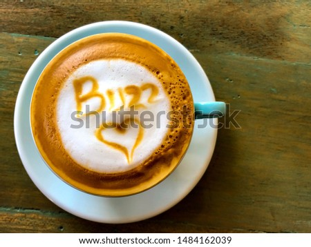 Photo of  Aerial view of a cappuccino with buzz and heart design.