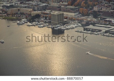 Aerial view of a chartered seaplane landing at Lake Union in Seattle, WA