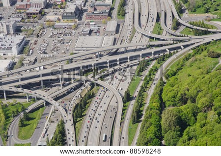 Aerial view of a complex interchange during rush hour